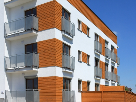 Modern apartment building. Freshly painted generic residential architecture