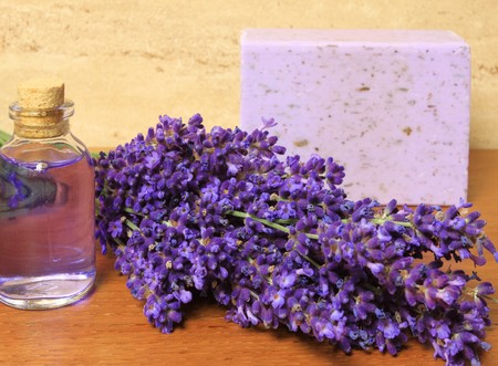 Relaxing spa resort composition - bath soap, bottle with lotion, lavender flower photo