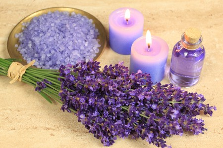 Spa composition - lavender flowers, coloured bathing salt and candles photo