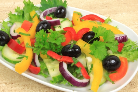 Salad with peppers, black olives and red onion.