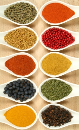 Colorful spices in ceramic containers - beautiful kitchen image.