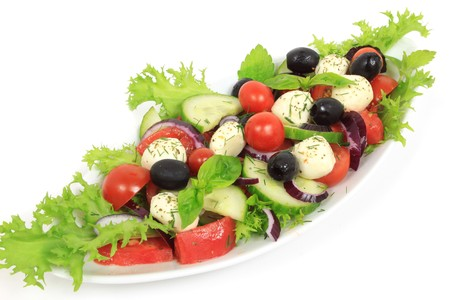 Fresh cherry tomatoes salad with seasoned mozzarella cheese, olives, cucumber, onions and green arugula