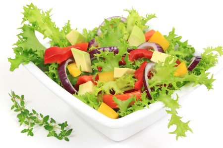 Fresh salad with peppers, lettuce, onions and avocado photo