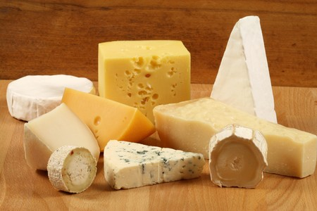Variety of cheese: camembert, gouda, parmesan,  sheep and other hard cheeses photo