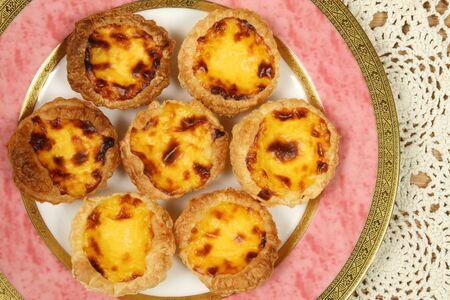 nata: Portugese pastries - pasteis de nata. Delicious home made cuisine. Stock Photo