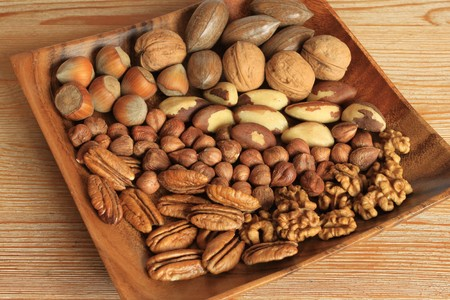 hazel nut: Mixture of nuts in wooden bowl. Christmas cuisine. Stock Photo