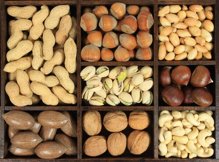 Assorted nuts in wooden box. photo