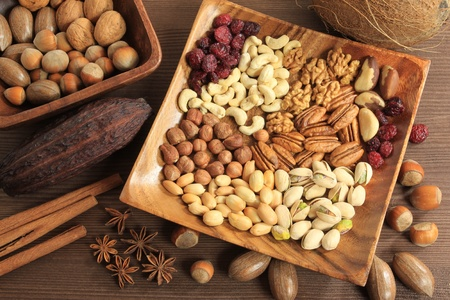 hazelnut: Assorted nuts in wooden bowl. Stock Photo