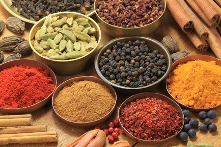 spices: Spices and herbs in metal  bowls. Food and cuisine ingredients. Colorful natural additives.