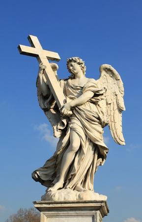 Famous Ponte Sant Angelo bridge. Baroque angel sculpture by Ercole Ferrata. Italy - Rome. photo