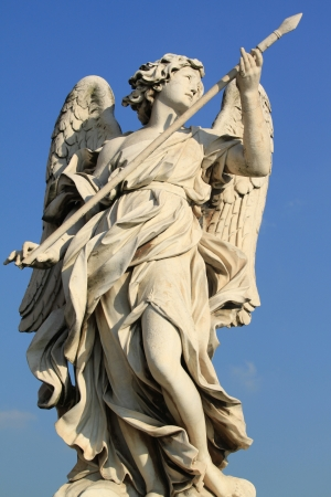 Italy - Rome. One of the angels at famous Ponte Sant' Angelo bridge. Angel with the Lance by Domenico Guidi. Standard-Bild