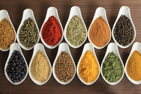 fenugreek: Colorful spices in ceramic containers - beautiful kitchen image.