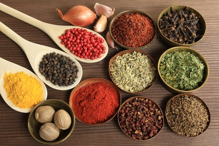 spices: Spices and herbs in metal  bowls and spoons. Food and cuisine ingredients. Stock Photo