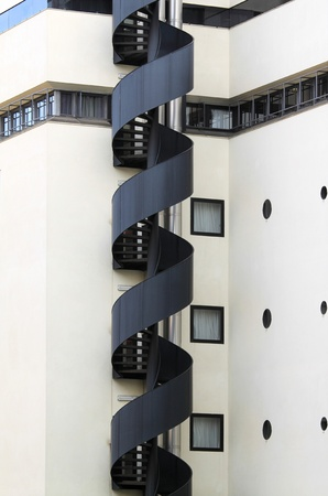evacuate: Evacuation staircase - modern architecture exterior. Emergency equipment in the city.