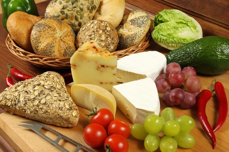 Food assortment in basket and on the table. photo