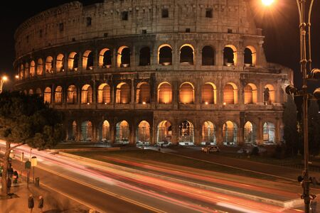 Rome, Italy. Famous Colosseum by night. Ancient landmark. photo
