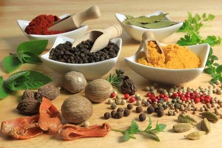 additives: Cooking ingredients - herbs and spices. Food additives: pepper, turmeric, mint, parsley and bay laurel leaves. Stock Photo