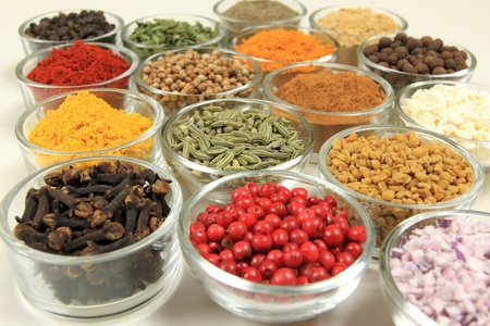 dried herb: Cuisine ingredients - herbs and spices. Food additives in glass bowls. Stock Photo