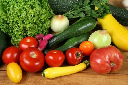 tomatos: Colorful choice of vegetables: tomatos, onion, zucchini, lettuce,  radish and  parsley