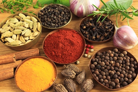 additives: Spices and herbs in metal  bowls. Food and cuisine ingredients. Colorful natural additives.