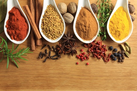 Various spices selection. Food ingredients and aromatic additives. Natural dried cuisine elements. photo
