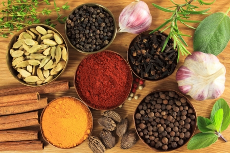 seasonings: Spices and herbs in metal  bowls. Food and cuisine ingredients. Colorful natural additives.