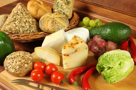 Food assortment in basket and on the table.