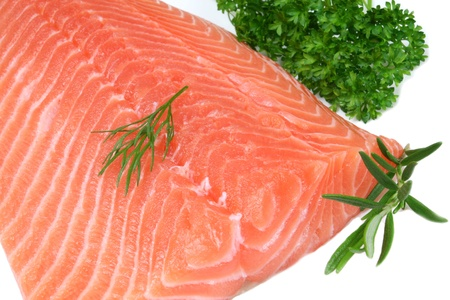 Raw salmon with dill and parsley. Sea food.