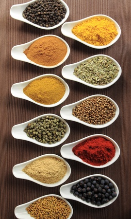 Colorful spices in ceramic containers - beautiful kitchen image. photo