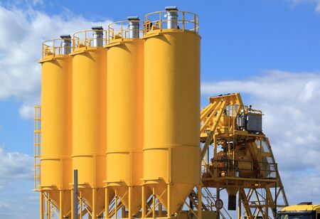 A group of processing silos of a concrete factory . Industrial structure