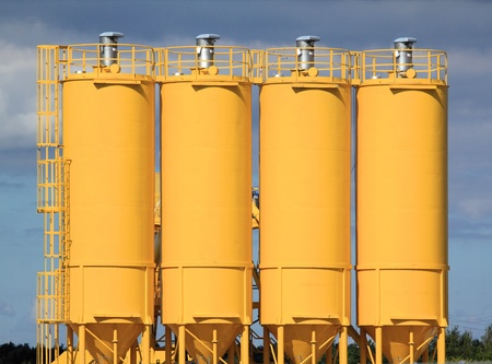 A group of processing silos of a concrete factory . Industrial structure  Stock Photo
