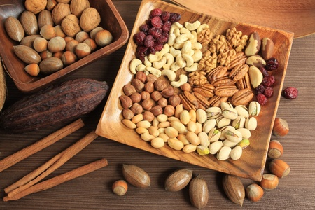 Varieties of nuts: peanuts, hazelnuts, chestnuts, walnuts, cashews, pistachio and pecans. Food and cuisine. Stock Photo - 10885872