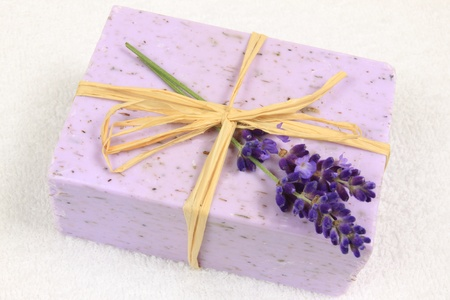 Close up on hand made lavender soap and flowers photo