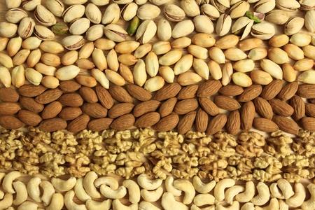 anacardo: Variedades de frutos secos: cacahuates, nueces, anacardos, pistachos y almendras. Alimentos y la cocina.