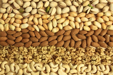 Varieties of nuts: peanuts, walnuts, cashews, pistachio and almonds. Food and cuisine. photo