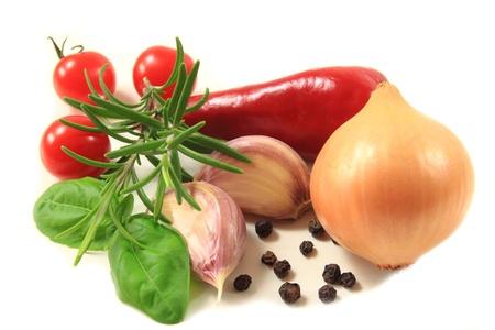 tomatos: Vegetables against white background: onion, cherry tomatos, rosemary and garlic