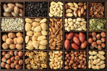Varieties of nuts: peanuts, hazelnuts, chestnuts, walnuts, cashews, pistachio and pecans. Food and cuisine. Stock Photo - 11297712