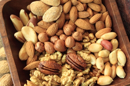 Types of nuts: peanuts, hazelnuts, chestnuts, walnuts, cashews, pistachio and pecans. Food and cuisine. Stock Photo - 11552714