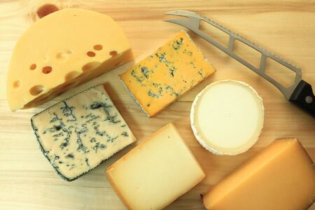 moulded: Cheese board - various types of soft and hard cheese.