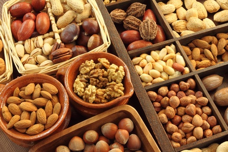 Varieties of nuts: peanuts, hazelnuts, chestnuts, walnuts,  pistachio and pecans. Food and cuisine. Stock Photo - 11904033