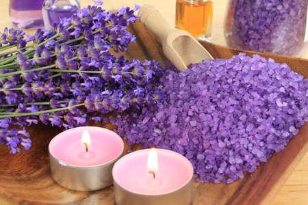 Spa resort and wellness composition - lavender flowers, coloured bathing salt photo