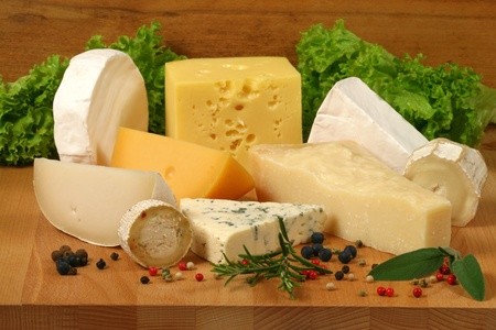 Dairy delicacies. Variety of cheese: camembert, gouda, brie, parmesan, goat, sheep and other hard cheeses. photo