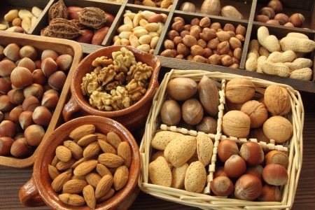Varieties of nuts: peanuts, hazelnuts, chestnuts, walnuts,  pistachio and others. Stock Photo - 13036698