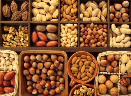 Varieties of nuts: peanuts, hazelnuts, chestnuts, walnuts,  pistachio and others. photo