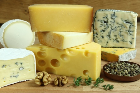 molds: Cheese board - various types of soft and hard cheese. International dairy delicacies.