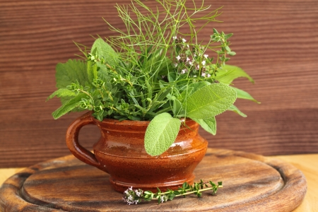 Bunch of fresh aromatic herbs in pot. photo