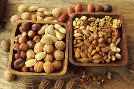 Varieties of nuts: peanuts, almonds, chestnuts, walnuts,  pistachio and pecans. Food and cuisine. Stock Photo - 14004113