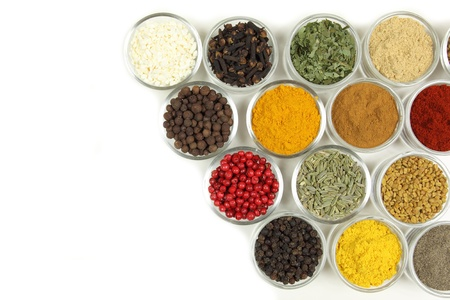 fenugreek: Spices and herbs in small glass bowls. Food and cuisine additives.