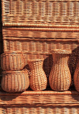 furniture store: Outdoor market stall with wicker baskets. Handicraft in Poland.