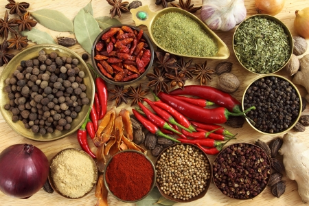 spices and herbs: Spices and herbs in metal  bowls. Food and cuisine ingredients. Colorful natural additives.